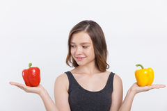 Girl with bell peppers Stock Photo