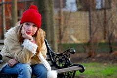 Girl on bench Stock Image