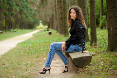 Girl on a bench Stock Images