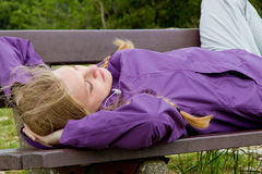 Girl on a bench Royalty Free Stock Image