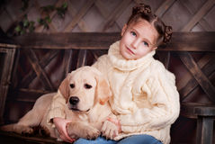 Girl on bench. Girl and dog sitting on a bench Royalty Free Stock Photo