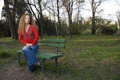 Girl on a bench Royalty Free Stock Photos