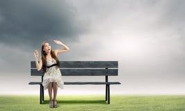 Girl on bench Stock Photos