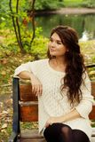 Girl on bench in autumn park Royalty Free Stock Photos