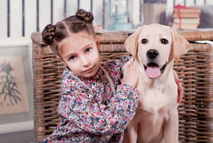 Girl on bench. Girl and dog sitting on a bench Royalty Free Stock Photography