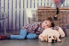 Girl on bench. Girl and dog sitting on a bench Royalty Free Stock Image