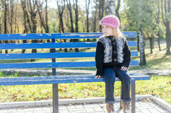 Girl on the bench Royalty Free Stock Photography
