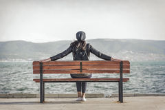 Girl on the bench near the sea. Royalty Free Stock Photography