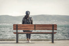 Girl on the bench near the sea. Stock Images