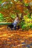 Girl on a bench in park Stock Photography