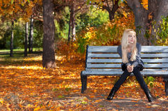 Girl on a bench in park Stock Image