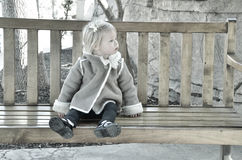 Girl on a bench Stock Image