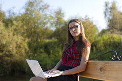Girl on bench work with laptop Royalty Free Stock Images