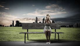 Girl on bench Stock Images
