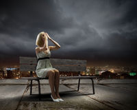 Girl on bench Royalty Free Stock Image
