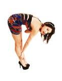 Girl bending down. Royalty Free Stock Photos