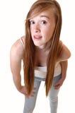 Girl bending forward. stock photography