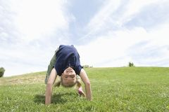 Girl Bending Over Backwards On Grass Royalty Free Stock Images