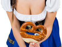Girl bending and showing pretzel Royalty Free Stock Photography