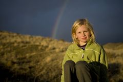 Girl beneath a rainbow Royalty Free Stock Photos