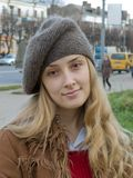 Girl in beret. Smiling girl in beret at autumn street Stock Images