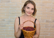 Girl with berries. Woman holds a basket of berries Stock Photo
