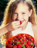 Girl with berry Stock Image