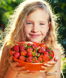 Girl with berry Stock Photos