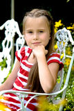 Girl betwin flowers Royalty Free Stock Photography