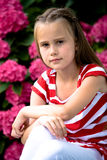 Girl betwin flowers Stock Photography