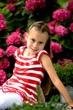 Girl betwin flowers Royalty Free Stock Image