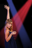 Girl with beverage. Girl with beverage on disco dancing Stock Image