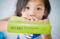 Girl and Bible. The girl show her Bible stock image