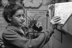 Girl with Bible. STARA, UKRAINE - 23 December 2008: The school girl with Bible for children at classroom Stock Image