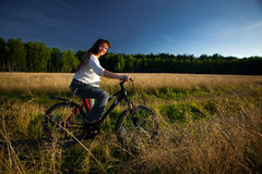 Girl with bicycle Royalty Free Stock Photos