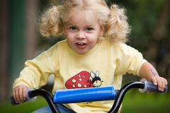 Girl on bicycle. A little girl on bicycle Royalty Free Stock Photography