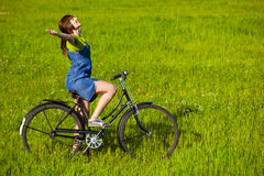 Girl with a bicycle Stock Photos
