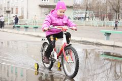 Girl on a bicycle Stock Images