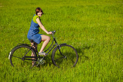 Girl with a bicycle Stock Images