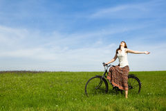 Girl with a bicycle Stock Photography