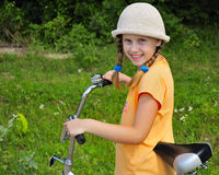 The girl on a bicycle Royalty Free Stock Photos