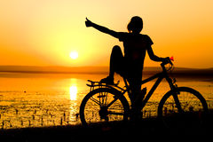 Girl with bicycle. Royalty Free Stock Photography