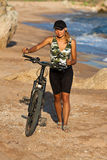Girl with bicycle. Stock Photo