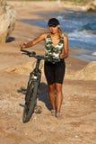 Girl with bicycle. Stock Photo