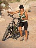Girl with bicycle. Stock Image