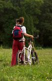 Girl with bicycle. Sporty young girl with bicycle stock image