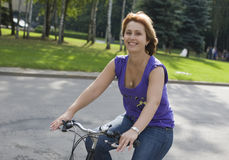 The girl on a bicycle Stock Photography