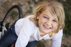 Girl on bicycle. Child on a bike outdoors Stock Images