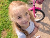 Girl with bicycle Stock Photos