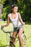 Girl and bicycle Stock Photo